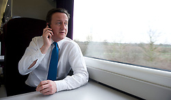 Leader of the Conservative Party David Cameron on his phone on the train to Leeds on day one of the General Election Campaign, Tuesday April 6, 2010, Photo By Andrew Parsons / i-Images