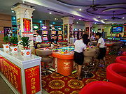 """13 FEBRUARY 2019 - SIHANOUKVILLE, CAMBODIA: The inside of a small gaming room at the White Sand Resort and Casino in Sihanoukville. There are about 80 Chinese casinos and resort hotels open in Sihanoukville and dozens more under construction. The casinos are changing the city, once a sleepy port on Southeast Asia's """"backpacker trail"""" into a booming city. The change is coming with a cost though. Many Cambodian residents of Sihanoukville  have lost their homes to make way for the casinos and the jobs are going to Chinese workers, brought in to build casinos and work in the casinos.      PHOTO BY JACK KURTZ"""