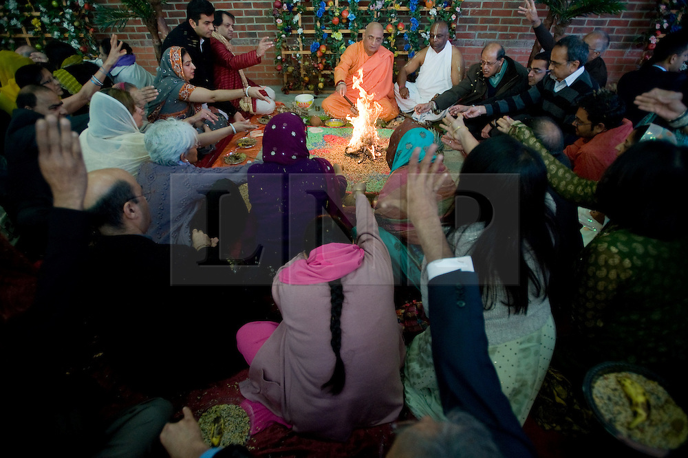 """© under license to London News pictures.  06/11/2010.Seed being thrown onto a fire as part of Celebrations for Diwali, the Hindu new year, at Gokul Centre for Cow Protection and Working Oxen in Aldenham near Watford, Hertfordshire today (Sat). The centre, which was originally donated by George Harrison, is unique in the western world producing """"Ahimsa Milk"""" at a cost of £3 per litre without harm to any living being. The Centre is part of Bhaktivedanta Manor, a Hindu place of worship."""