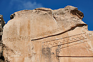 """Close up of the inscription dedicated to King Midas on the Phrygian rock Monument known locally as Yazilikaya, ( written rock ) . 8th - 6th century BC . Midas City, Yazilikaya, Eskisehir, Turkey.<br /> <br /> This is the largest Phrygian rock cut facade monument, measuring 17m x 16.5m. It represents the front of a Phrygian megaron type building with a low pitched roof. It is known locally as yazilikaya , which means """"written rock"""", because of the Paleo-Phrygian inscriptions carved above the rock above the roof outline, down the right side and in the niche. The upper inscription dedicates the monument to King Midas, and so it is also known as the """"Midas Monument"""". The niche probably contained an image of the Phrygian Mother  Goddess, and the word """"Matar"""" (Mother) is inscribed inside. The monument was carved  around the 8th and  6th century BC. .<br /> <br /> If you prefer to buy from our ALAMY PHOTO LIBRARY  Collection visit : https://www.alamy.com/portfolio/paul-williams-funkystock/ancient-midas-turkey.html<br /> <br /> Visit our CLASSICAL WORLD HISTORIC SITES PHOTO COLLECTIONS for more photos to download or buy as wall art prints https://funkystock.photoshelter.com/gallery-collection/Classical-Era-Historic-Sites-Archaeological-Sites-Pictures-Images/C0000g4bSGiDL9rw"""