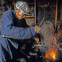 MONGOLIA. Auvsan, an 84-year old blacksmith makes many of the critical buckles, bridles, and other metal tools needed in the Darhad Valley.
