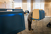 Voters cast ballots at a polling location in Downtown Minneapolis, Minnesota, U.S., on Tuesday, Aug. 11, 2020. Photographer: Ben Brewer/Bloomberg