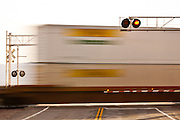 Freight trains pass the BNSF grade crossing at National Trails Highway and Amboy Road along the old Route 66 in the Mojave Desert Amboy, CA