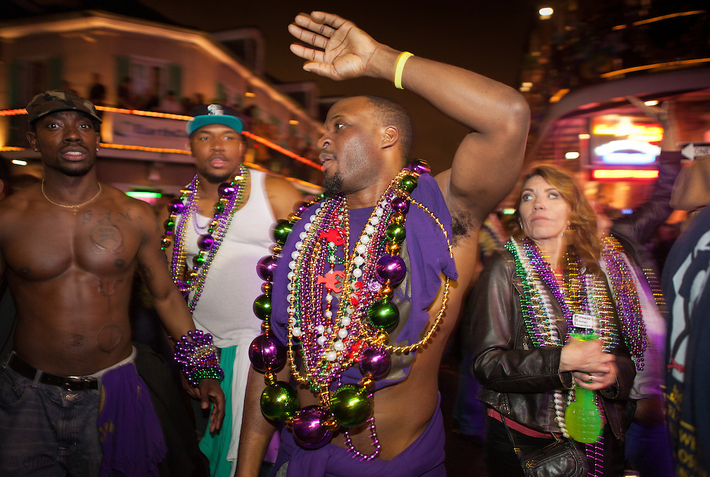 People celebrate Mardi Gras on Bourbon Street on Fat Tuesday in New Orleans. Mardi Gras 2011 in New Orleans is expected to be have the largest attendance of all time due to the dates overlapping with college spring break. Mardi Gras also known as Carnival begins on or after Epiphany and ending on the day before Ash Wednesday.