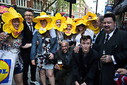 Hen party friends with daffodil constumes have their photo taken with a group of Teddy Boys in London, United Kingdom. A bachelorette party, hen party, hen night or hen do, is a party held for a woman who is about to get married. The terms hen party, hen do or hen night are common in the UK.