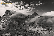 Rolling fog clouds with Heavy Runner and Reynold Mountains at Logan Pass in Glacier National Park, USA