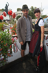 06.10.2013, Kaefers Wiesenschaenke, Muenchen, GER, der FC Bayern Muenchen beim Oktoberfest, im Bild Pep Guardiola, head coach of Bayern Muenchen poses with his wife Christina Guardiola in front of the ensemble of the Bavaria statue, a monumental bronze sand-cast 19th-century statue and the Hall of Fame (Ruhmeshalle). The Bavaria is the female personification of the Bavarian homeland and by extension its strength and glory // during the Oktoberfest 2013 beer festival at Kaefers Wiesenschaenke in Munich, Germany on 2013/10/06. EXPA Pictures © 2013, PhotoCredit: EXPA/ Eibner/ Eckhard Eibner<br /> <br /> ***** ATTENTION - OUT OF GER *****