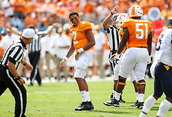 Sep 1, 2018; Charlotte, NC, USA; Tennessee Volunteers quarterback Jarrett Guarantano (2) reacts after being hit by West Virginia Mountaineers safety Toyous Avery (3) during the first quarter at Bank of America Stadium. Mandatory Credit: Ben Queen-USA TODAY Sports