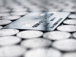 Dec. 14, 2012 - Credit card amongst coins (Credit Image: © Image Source/ZUMAPRESS.com)
