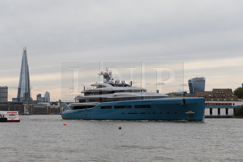 © Licensed to London News Pictures. 12/09/2018. London, UK.  Billionaire Spurs owner, Joe Lewis's 321 feet long luxury superyacht Aviva leaves London passing the Shard and skyscrapers on the River Thames following a London visit. Aviva, worth an estimated £113m is one of a growing number of superyachts to visit the capital this year and moored near Butlers Wharf for a number of weeks, during which wealthy homeowners criticised the Spurs owner for spoiling their river view.  Photo credit: Vickie Flores/LNP