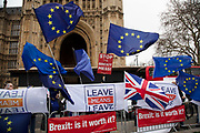 Anti Brexit pro Europe alongside Vote Leave demonstrators protest waving European Union and Union Jack flags in Westminster on the day of the 'meaningful vote' when MPs will back or reject the Prime Minister's Brexit Withdrawal Agreement on 15th January 2019 in London, England, United Kingdom.