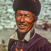 Village elder in Manang with gold teeth from Bangkok wearing typical Tibetan coral beads.