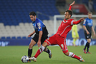 Adam Smith of Bournemouth is tackled by Juan Cala of Cardiff. Capital One Cup, 3rd round match, Cardiff City v AFC Bournemouth at the Cardiff City stadium in Cardiff, South Wales on Tuesday 23rd Sept 2014<br /> pic by Mark Hawkins, Andrew Orchard sports photography.
