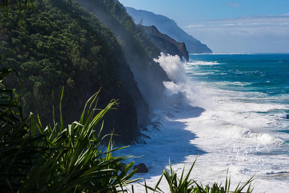 Huge storm wave exploding onto the cliffs of the Na Pali Coast, Kauai, Hawaii