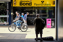 A busker plays in Basildon Town Centre. Essex