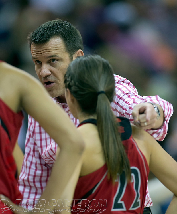 Louisville head coach Jeff Walz talks to his players during a timeout in the first half of their NCAA Women's Basketball Championship National Semifinal game, Sunday, April 7, 2013 at New Orleans Arena in New Orleans. (D. Ross Cameron/Staff)