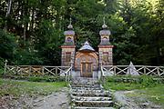The wooden church (Ruska Capela) built by Russian Prisoners of War during WW1, in honour of their comrades who died building the Vrsic Pass road (Ruska Cesta) near kranjska Gora, on 22nd June 2018, in Triglav National Park, Julian Alps, Slovenia.