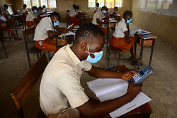 August 17, 2020, Lagos, Nigeria: Final year students of Agidinbi Senior Grammar School,Ikeja, Lagos, wearing a facemask write on examination answer sheets during The West African Senior Secondary Certificate Examinations, after their two weeks resumption, on Monday, August 17, 2020. The government has lifted lockdown order over COVID-19 pandemic and allowed final year Students to resume school August 4, 2020 in preparation for their examinations. (Credit Image: © Olukayode Jaiyeola/NurPhoto via ZUMA Press)