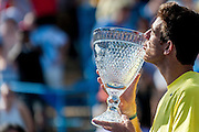 Argentina's Juan Martin Del Potro kisses the trophy after defeating USA's John Isner during their men's final singles match at the Citi Open ATP tennis tournament in Washington, DC, USA, 4 Aug 2013. Del Potro won the final 3-6, 6-1, 6-2.