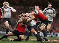 Photo: Rich Eaton.<br /> <br /> Wales v Canada. Invesco Perpetual Series. 17/11/2006. Sonny Parker in centre of Wales is tackled by the Canadian defence