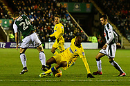 Jimmy Abdou (8) of AFC Wimbledon battles for possession with David Fox (24) of Plymouth Argyle during the EFL Sky Bet League 1 match between Plymouth Argyle and AFC Wimbledon at Home Park, Plymouth, England on 13 February 2018. Picture by Graham Hunt.
