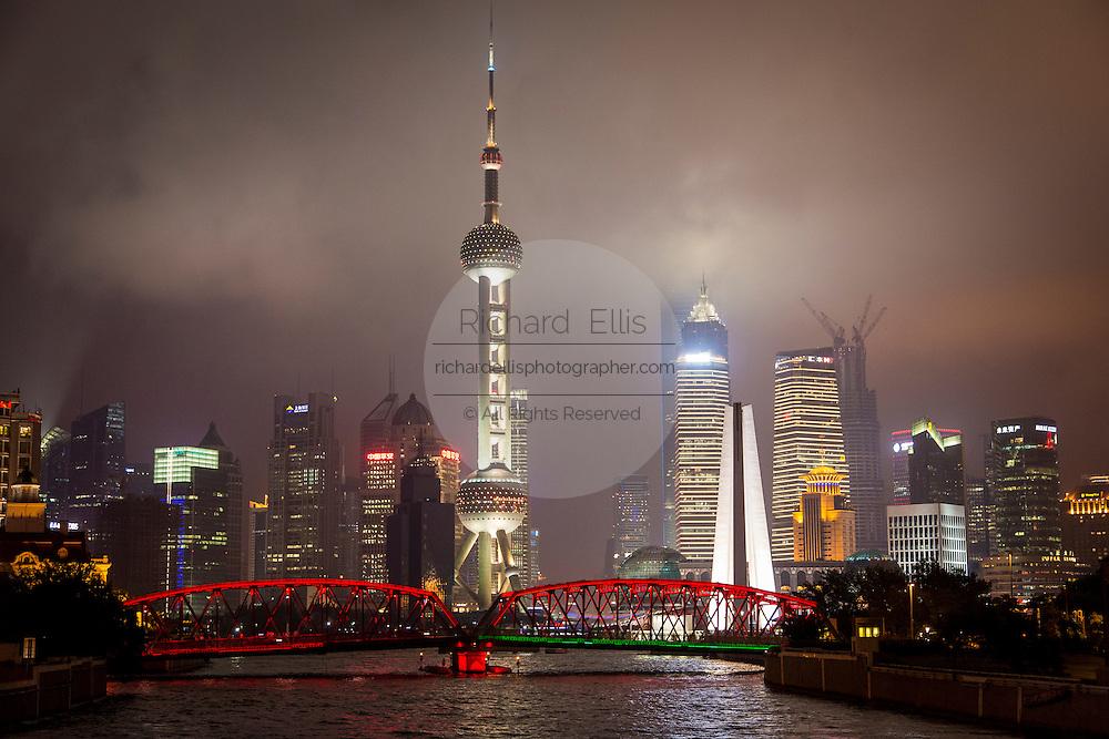 Colored lights on the Waibaidu Bridge with the Pudong skyline Shanghai, China