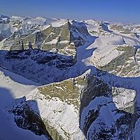 BAFFIN ISLAND, Nunavut, CANADA. Glaciated mountains between Eglinton & Sam Ford Fjords. Eglinton Tower foreground (?).