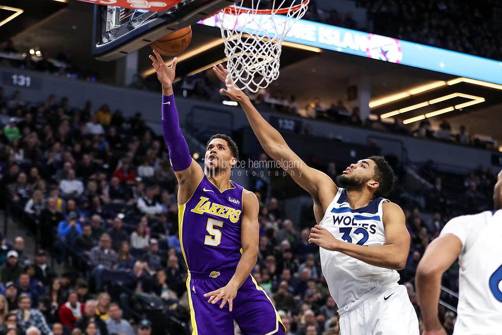 Feb 15, 2018; Minneapolis, MN, USA; Los Angeles Lakers guard Josh Hart (5) shoots over Minnesota Timberwolves center Karl-Anthony Towns (32) at Target Center. Mandatory Credit: Brace Hemmelgarn-USA TODAY Sports