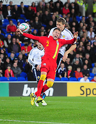 Scotland's Darren Fletcher (Manchester United) sees his header hit the hand of Wales Chris Gunter (Reading) in the penalty area but it's missed by the referee - Photo mandatory by-line: Joe Meredith/JMP  - Tel: Mobile:07966 386802 12/10/2012 - Wales v Scotland - SPORT - FOOTBALL - World Cup Qualifier -  Cardiff   - Cardiff City Stadium -
