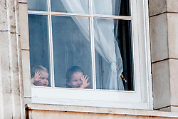 Princess Charlotte and Prince Louis of Cambridge. British Royal family on the balcony during celebration of the Trooping the Colour in London, UK, on June 08, 2019. Meghan Duchess of Sussex Princess Meghan Markle and Prince Harry British Royal Family at Trooping the Colour Queen Elizabeth, The Prince of Wales Charles, The Duchess of Cornwall Camilla, The Duke and Duchess of Cambridge, Prince George, Princess Charlotte Prince Louis Arthur Charles , Prince Andrew and Princess Anne in London, United Kingdom, trooping the colour , The annual trooping the color is to honor the Queens official birthday. Photo by Robin Utrecht/ABACAPRESS.COM