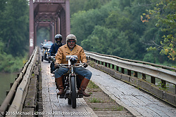 Frank Westfall of New York riding his 4-cylinder 1912 Henderson class-2 bike over the treacherous to motorcycles, wooden Wabash Cannonball Bridge in St. Francisville, Illinois during the Motorcycle Cannonball Race of the Century. Day-4 ride from Bloomington, IN to Cape Girardeau, MO. USA. Wednesday September 14, 2016. Photography ©2016 Michael Lichter.