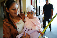 In the doorway of St. Mary's in Salinas, a young parishioner makes an Palm Sunday entrance.