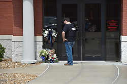August 7, 2017 - USA - Flowers in memory of officer Gary Michael have been placed at the front door to the Clinton Police Department in Clinton, Missouri, Monday, August 7. (Credit Image: © Keith Myers/TNS via ZUMA Wire)