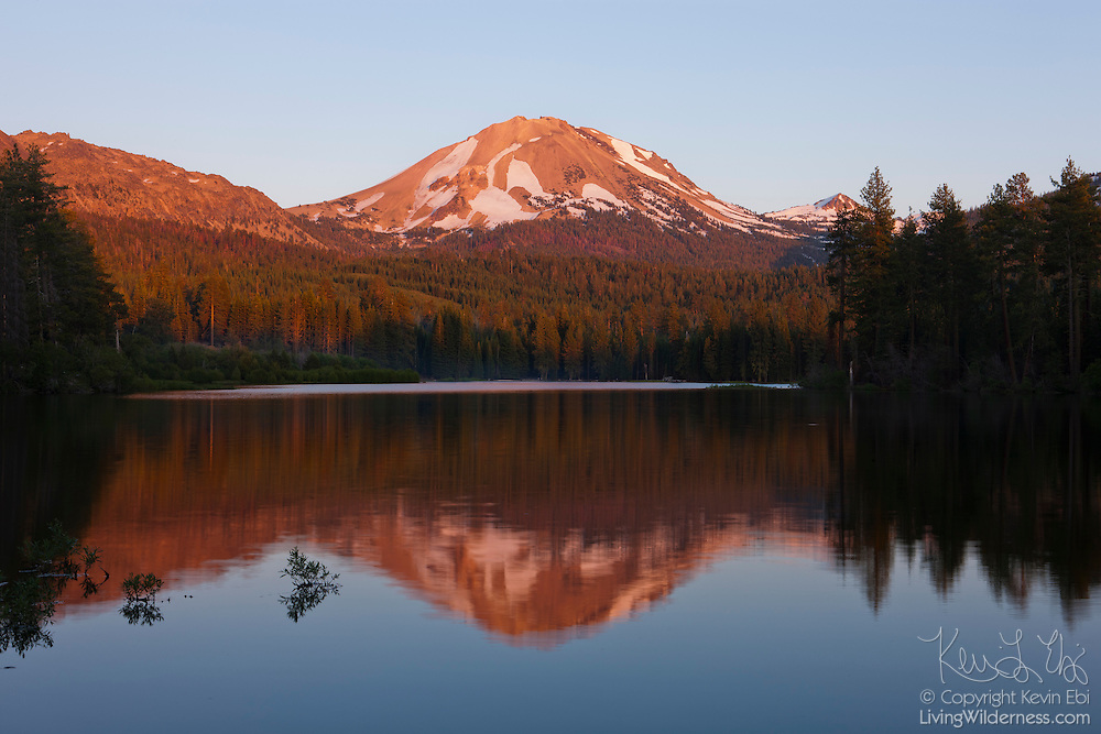 Lassen Peak, a 10,462 foot (3,189 meter) volcano in northern California, is reflected in Manzanita Lake at Sunset. Lassen Peak is the southernmost volcano in the Cascade Range and last erupted from 1914-1917.