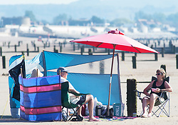 ©Licensed to London News Pictures 07/08/2020  <br /> St Mary's Bay, UK. Early risers all set up for a day at the beach. St Mary's Bay in Kent on the south coast is already starting to hot up with people arriving for a day on the beach. Scorching hot weather today in the UK as the heatwave weather looks set to continue into next week. Today could be one of the hottest on record if not the hottest. Photo credit: Grant Falvey/LNP
