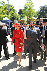 SHEIKH MOHAMMAD BIN RASHID AL MAKTOUM and his wife PRINCESS HAYA OF JORDAN at the second day of the 2010 Royal Ascot Racing festival at Ascot Racecourse, Berkshire on 16th June 2010.