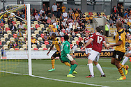 Chris Zebroski (far right) of Newport county scores his side's first goal. Skybet football league two match, Newport county v Northampton Town at Rodney Parade in Newport, South Wales on Saturday13th Sept 2014<br /> pic by Mark Hawkins, Andrew Orchard sports photography.