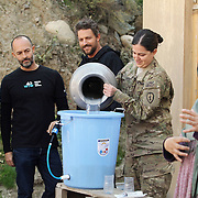 The Female Engagement Team (FET) with a translator giving a water filtration demonstration in the village of Nari, Kunar Province of Eastern Afghanistan with Waves For Water and the US Military.