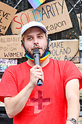 Jarek Kubiak, the founder of the Polish Rainbow UK, speaks to the audience gathered in front of the Polish Embassy in central London on Saturday, Aug 15, 2020 - to protest the latest Polish government crackdown on Polish LGBTQ activists. The arrest of a non-binary person on Aug. 7 underscores the growing crackdown against LGBTQ activists in Poland. Margot Szutowicz, who uses female pronouns, and nearly 50 others were arrested in Warsaw, the country's capital, while protesting Szutowicz's imminent arrest for allegedly causing damage to a truck promoting anti-LGBTQ messages and assaulting a pro-life demonstrator on June 2. (VXP Photo/ Vudi Xhymshiti)