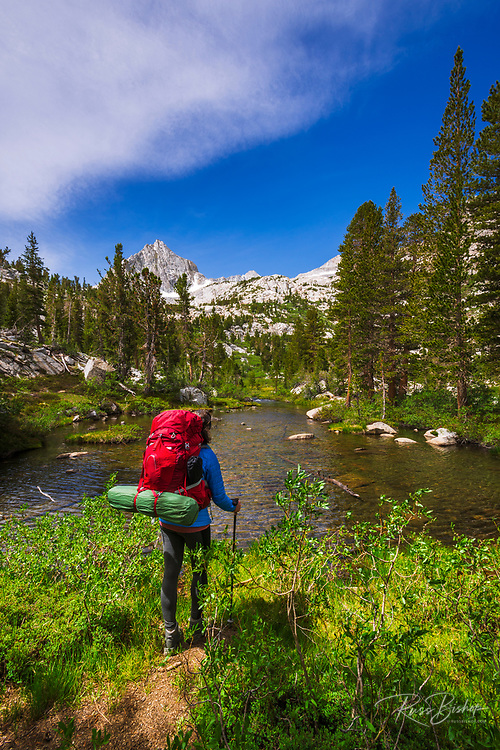 Backpacker on the Treasure Lakes trail at Bishop Creek, John Muir Wilderness, Sierra Nevada Mountains, California USA