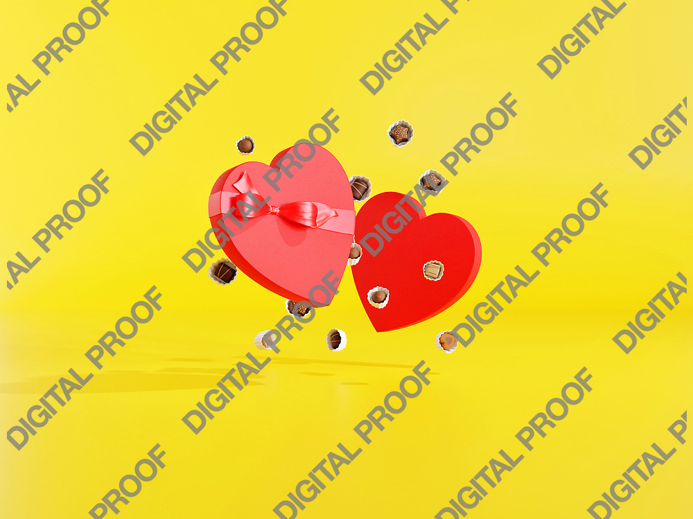 Open Chocolate Box with a heart shape with bonbons floating in the air in studio with yellow background - 3d rendering concept