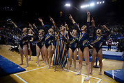 The Michigan Women's Gymnastics Team celebrates their win with fans in the crowd after the NCAA Regional Final at the Crisler Center on April 6, 2019 in Ann Arbor, Michigan.