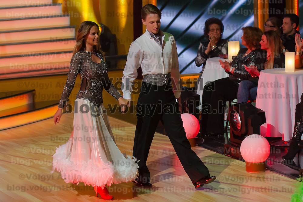 """Hajnalka Majros """"Dundika"""" and Mate Meszaros dance in the live broadcast celebrity dancing talent show Saturday Night Fever by Hungarian television company RTL II in Budapest, Hungary on March 16, 2013. ATTILA VOLGYI"""