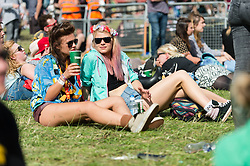 © Licensed to London News Pictures. 22/08/2014. Reading, UK.   Festival goers at Reading Festival 2014 on Friday, the opening day.    The weather is sunny with light cloud.   Today is expected to remain dry with a 25% risk of showers.  Photo credit : Richard Isaac/LNP
