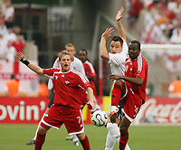Photo: Chris Ratcliffe.<br /> England v Trinidad & Tobago. Group B, FIFA World Cup 2006. 15/06/2006.<br /> John Terry from England clashes with Chris Birchall (L) and Stern John from T&T.