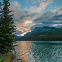 Dawn breaks over Mount Inglismaldie and Two Jack Lake in Banff National Park, Alberta, Canada.  Mount Girouard is on right.