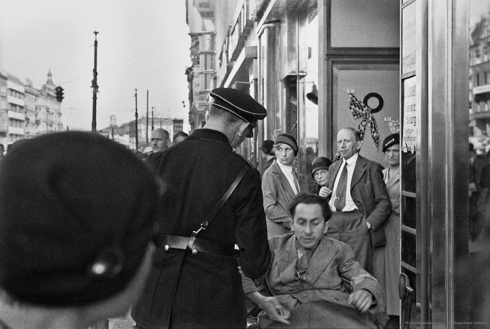 Crippled Jewish News-Seller in Tauenzienstrasse Being Apprehended by Officer in SS Uniform, Berlin, 1934