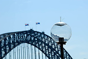Light fixture with anti-seagull spikes, Sydney Harbour Bridge in background. Circular Quay, Sydney, Australia