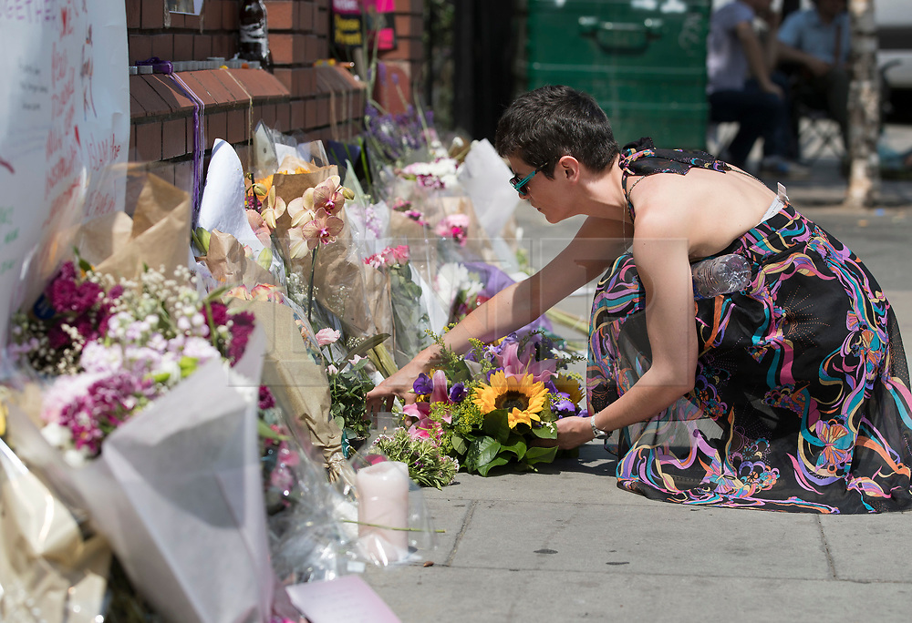 © Licensed to London News Pictures. 20/06/2017. London, UK. A woman places flowers outside Finsbury Mosque in north London after a van ploughed into a crowd nearby. One person has been killed and 10 people are injured. Darren Osborne, 47, from Cardiff, continues to be held on suspicion of attempted murder and alleged terror offences.  Photo credit: Peter Macdiarmid/LNP