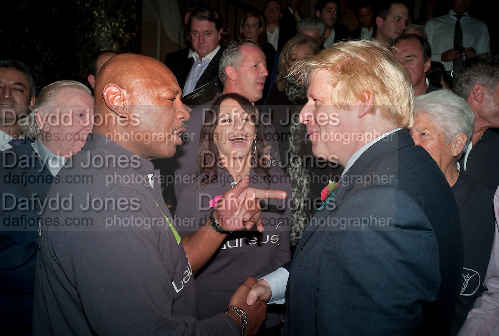 Marvin Hagler; Nadia Comaneci ; BORIS JOHNSON, Drinks soiree and silent auction of Ô100 ThingsÕ,  hosted by the Mayor of London Boris Johnson, in aid of the Legacy List. 50 St. James. London. 2 November 2011. <br /> <br />  , -DO NOT ARCHIVE-© Copyright Photograph by Dafydd Jones. 248 Clapham Rd. London SW9 0PZ. Tel 0207 820 0771. www.dafjones.com.<br /> Marvin Hagler; Nadia Comaneci ; BORIS JOHNSON, Drinks soiree and silent auction of '100 Things',  hosted by the Mayor of London Boris Johnson, in aid of the Legacy List. 50 St. James. London. 2 November 2011. <br /> <br />  , -DO NOT ARCHIVE-© Copyright Photograph by Dafydd Jones. 248 Clapham Rd. London SW9 0PZ. Tel 0207 820 0771. www.dafjones.com.